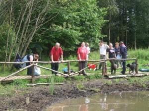 Volunteers by pond